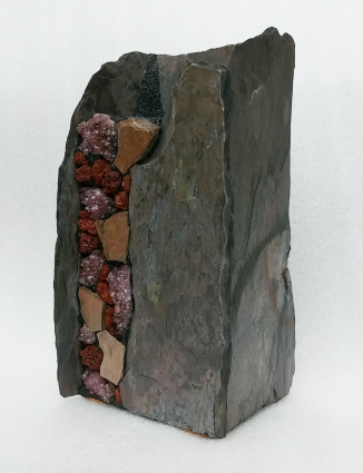tall stone vase with sodalite and obsidian