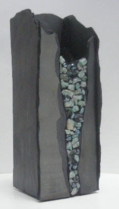 12 inch tall stone vase with emeralds